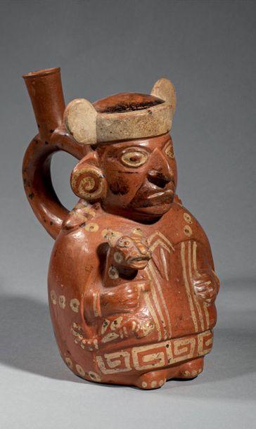 Vase étrier représentant un personnage assis...
