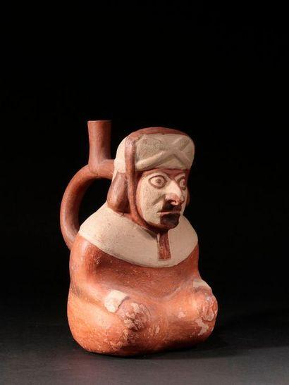 Vase représentant un personnage assis  Terre...