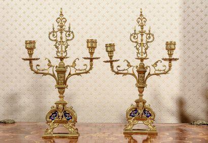 Paire de chandelier en métal doré à 2 bras...