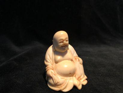 Netsuke en ivoire représentant un bouddha...