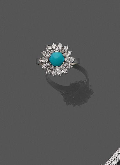 *BAGUE en or gris (750) centré d'une turquoise...