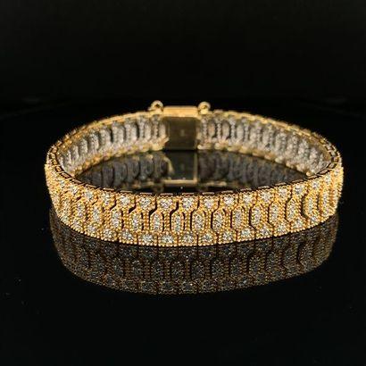 BRACELET en or jaune et or gris (750) articulé,...