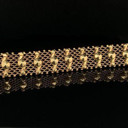 """BRACELET """" résille """" en or rose (750) ajouré, rehaussé de vingt motifs géométriques...."""