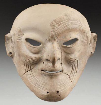 Masque cultuel présentant le portrait d'un...