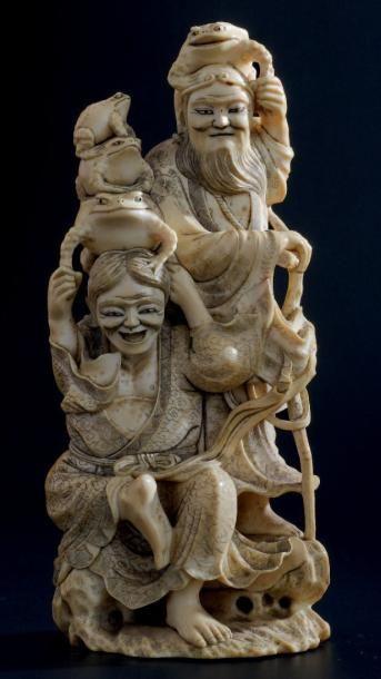 OKIMONO en ivoire, représentant un éleveur...