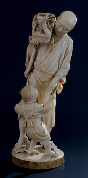OKIMONO en ivoire, représentant un pêcheur...
