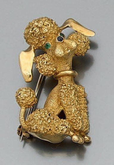 BROCHE «caniche» en or jaune (750 millièmes)...