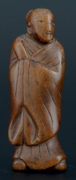 NETSUKE en bois représentant, un vieillard debout Japon XIXème siècle H: 17 cm
