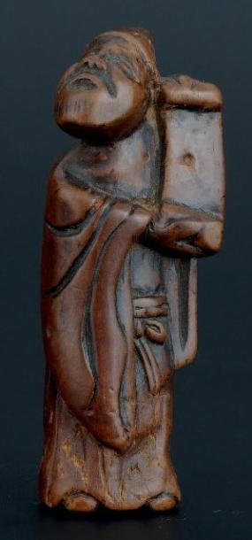 NETSUKE en bois représentant, un sage au...