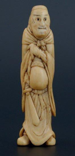 NETSUKE en ivoire représentant un très beau...