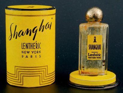 Lenthéric «SHANGHAI» Flacon miniature en verre de forme rectangulaire. Bouchon bille...