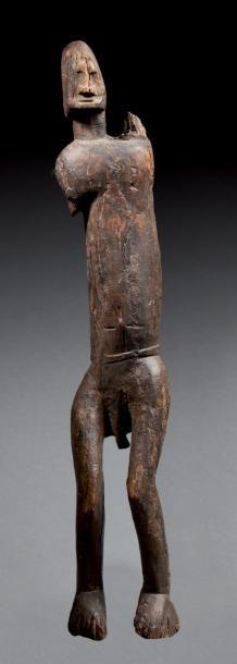 STATUE ANTHROPOMORPHE présentant, sculpté...