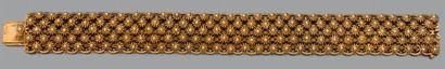 BRACELET «fleurettes» en or jaune (750 millièmes)...