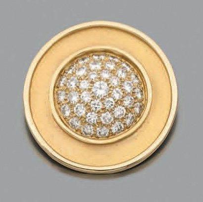 BROCHE circulaire en or jaune (750 millièmes)...