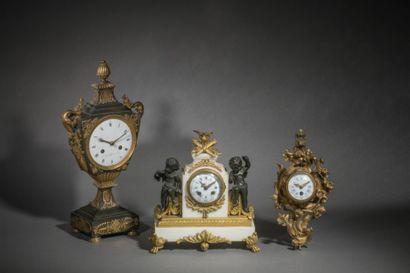 Pendule en bronze, marbre et bronze doré...