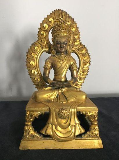 Statuette de Bouddha sur une base carré en...