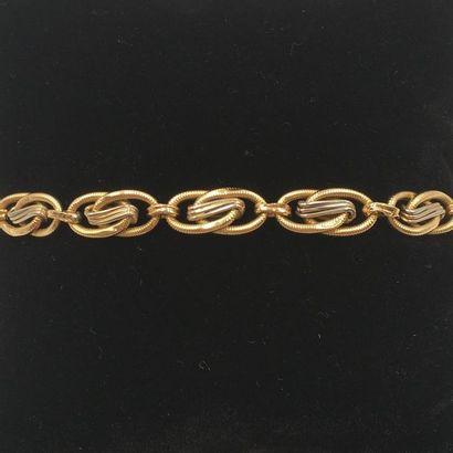 BRACELET deux tons d'or (750 millièmes) articulé,...