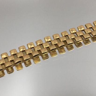 BRACELET articulé en or jaune (750 millièmes)...