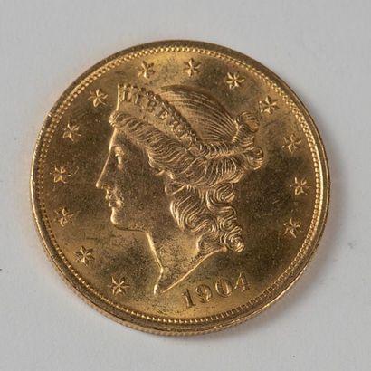 Une pièce en or de 20 dollars américain 1904...