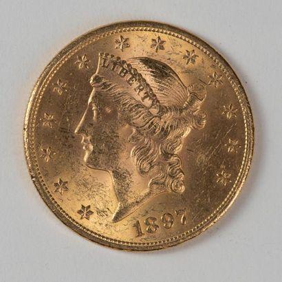 Une pièce en or de 20 dollars américain 1897...