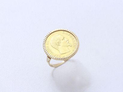 Bague en or 750 millièmes, ornée d'une pièce...