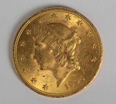Une pièce en or de 20 dollars 1904. Ce lot est vendu sur désignation.