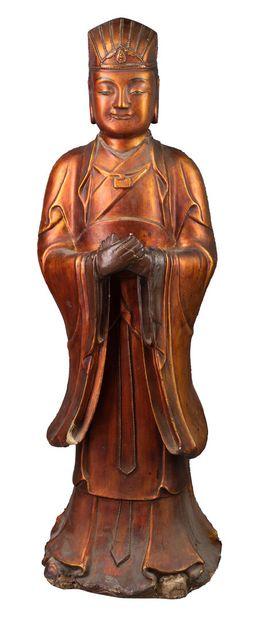 Grande sculpture en bois couvert de feuilles...