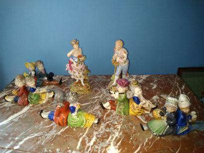 Ensemble de 10 petits sujets en porcelaine...