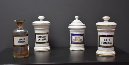 Set of 14 19th century glass and porcelain medicine jars. Ht 15 to 20 cm.
