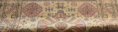 Carpet with geometric decoration, beige background. Carries a MASOGLU manufacturer's...