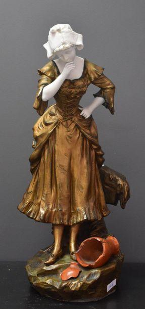 Sculpture en biscuit blanc et régule doré....