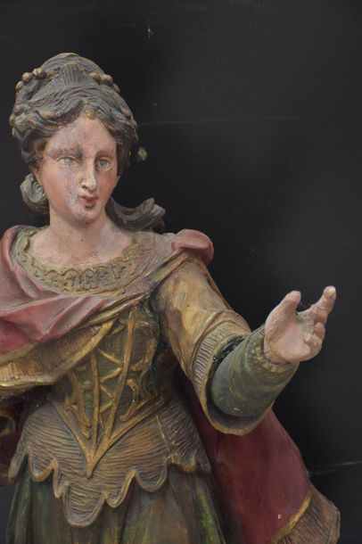 Imposing saint in carved and polychromed wood. Louis XIV period. Legs animated with...