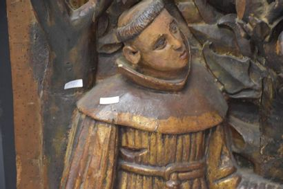 High relief in carved and polychromed wood representing a monk. Late 16th, early...
