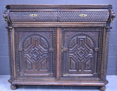 Renaissance period low furniture in carved oak, two doors and two drawers, cut sides...