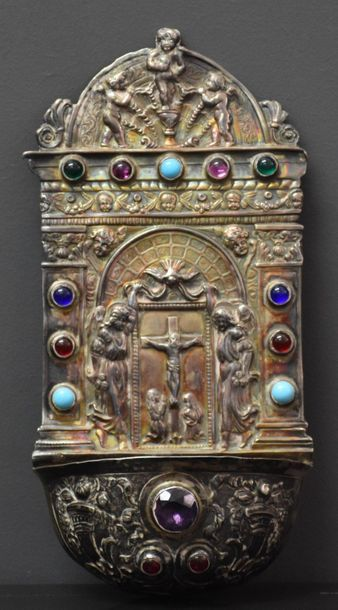 Silver stoup with relief decoration of Calvary surrounded by 2 angels and decorated...