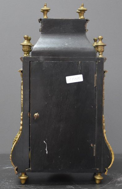 Louis XIV style cartel inlaid with brass, Napoleon III period. Ht 32 cm .