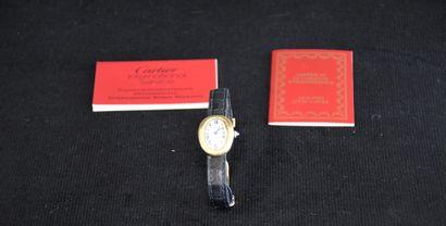 Montre dame Cartier or et bracelet cuir,...