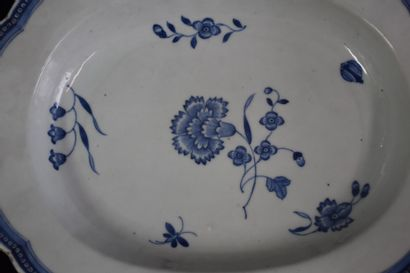 An 18th century Chinese porcelain dish decorated with flowers and butterflies. Length...