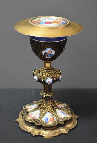 Neo-Gothic chalice and its silver paten. The work is enriched with 16 plates with...