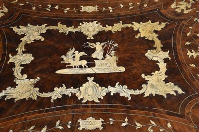 Italian table in veneer and marquetry of bone and ivory. Period XVIII th century....