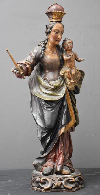 Mère à l'enfant en bois sculpté et polychromé...