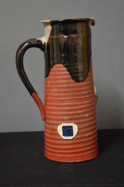Sumidagawa stoneware service. Japan around 1900 composed of a jug and six mugs.