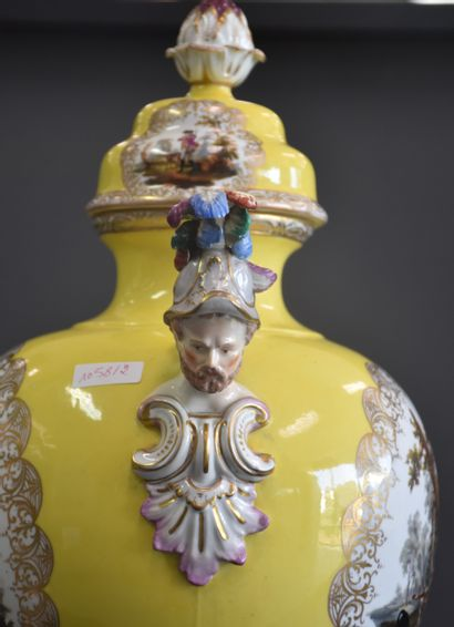 German porcelain vase with yellow background and handles in the shape of helmeted...