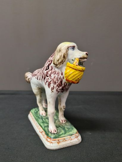 Delft earthenware dog, 18th century. Height : 14 cm. Trace of old glue on the two...