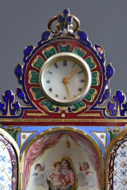 A miniature cloisonné and enamelled bronze watch case. Two small doors open onto...