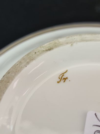 Set of two Brussels porcelain cups of the Empire period. One decorated in reserve...
