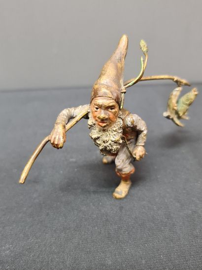Bronze of Vienna, the dwarf carp fisherman. The carps are hanging on with a small...