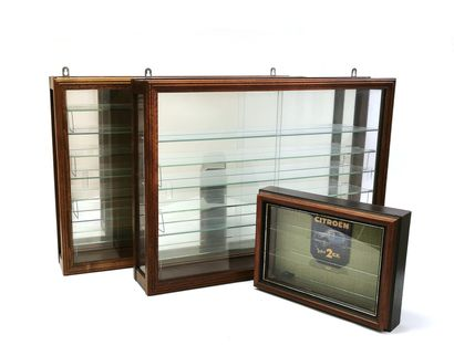 Pair of narrow wall-mounted display cases...