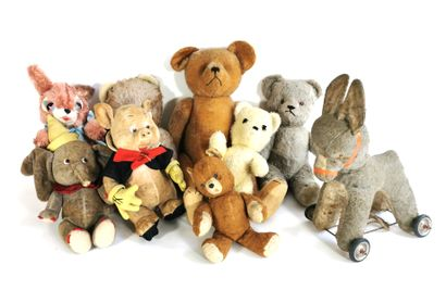 Lot of antique stuffed animals including...
