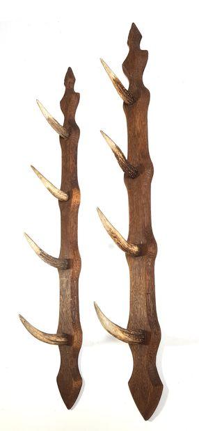 Porte fusil en bois naturel à quatre patères...